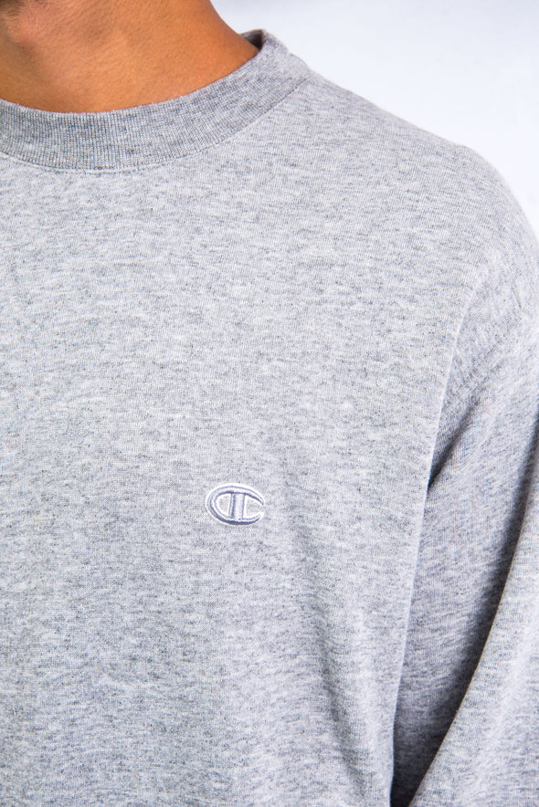 Vintage 90's grey champion sweatshirt with embroidered logo on chest