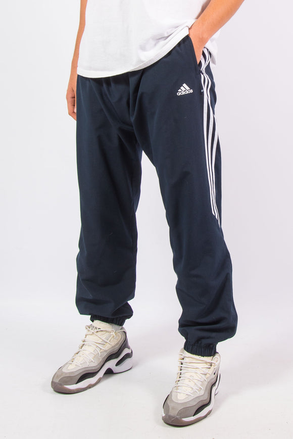Vintage Adidas three stripe navy blue tracksuit bottoms with elasticated cuffs