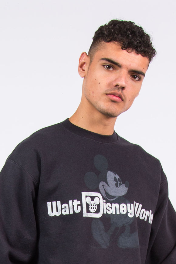 Y2K black Disney sweatshirt with printed graphic on chest
