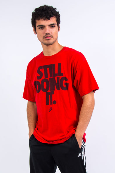 "Nike ""Still Doing It"" Graphic Print T-Shirt"