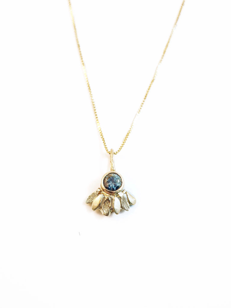 10k gold sapphire necklace hand made in tofino bc. Shop online or in store at the factory.