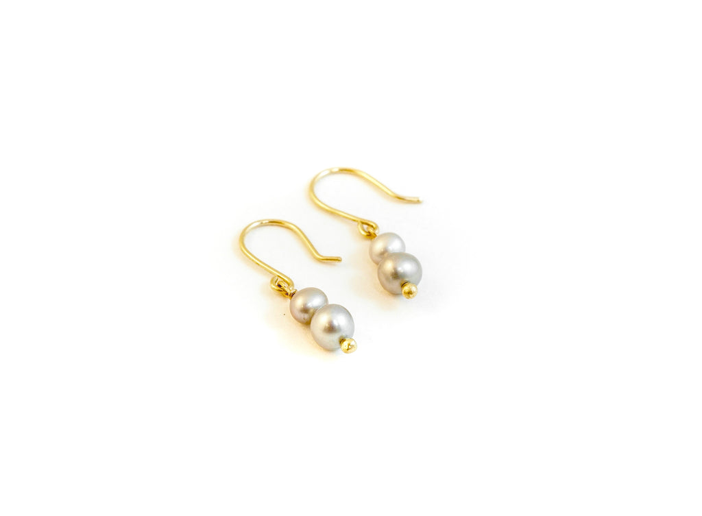 Pearl earrings in gold handmade on vancouver island in tofino. Shop local jewellery online