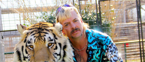 Big cats documentary star - Joe Exotic, posing with tiger