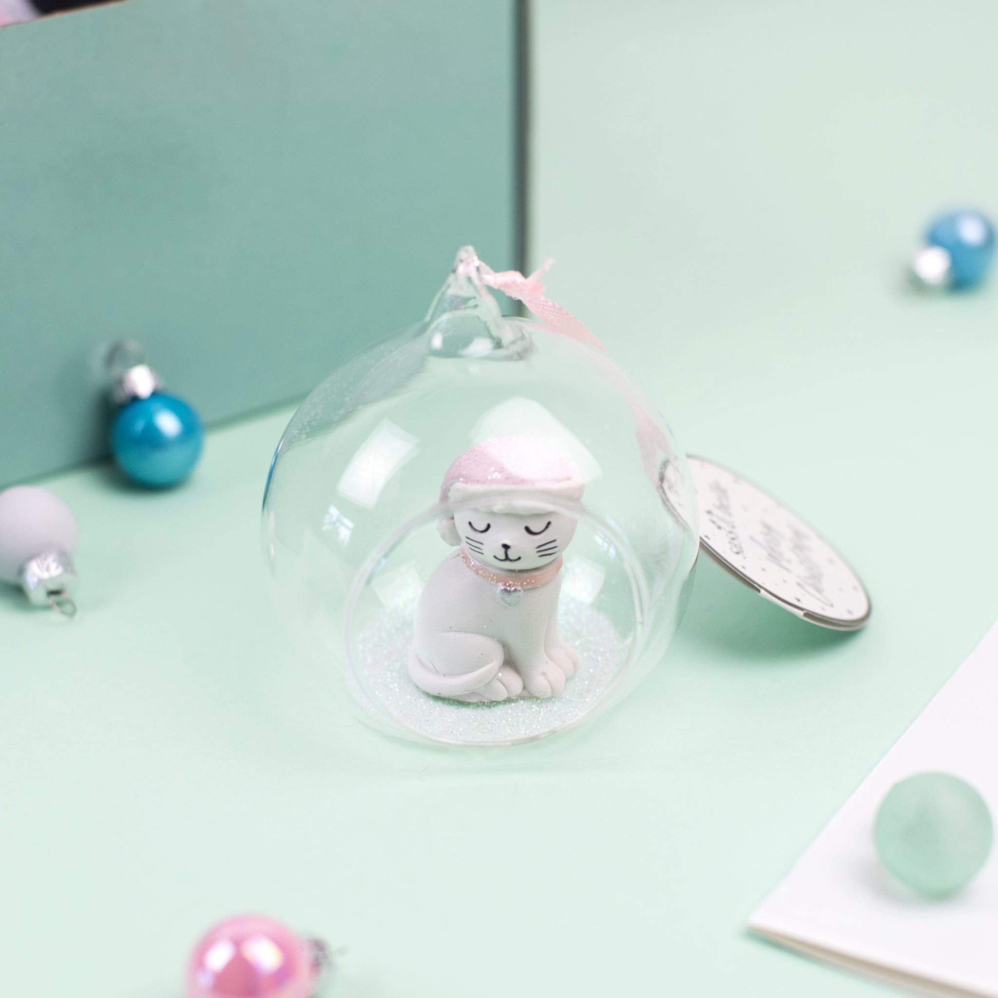Whimsical glass and glitter bauble