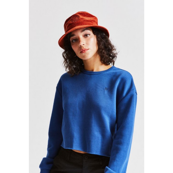 Woman wearing Brixton Oath bucket hat in Picante colour