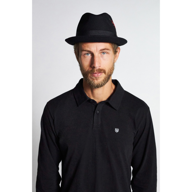 Man wearing black Brixton Gain fedora