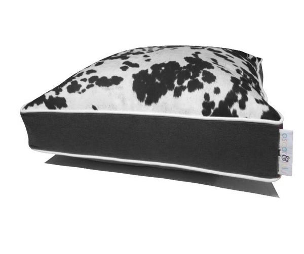 Black & cream faux cow hide dog bed, black sides & bottom with cream piping
