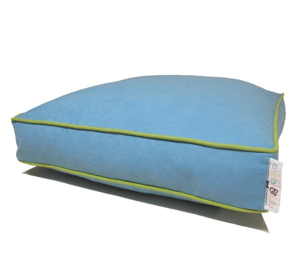 Light blue dog bed with light green piping