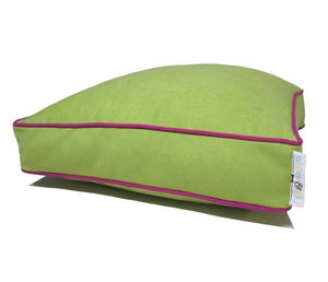 Light green dog bed with hot pink piping