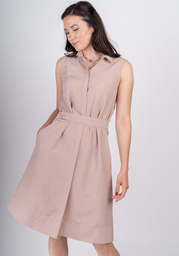 Woman looking to the side wearing Sonna belted dusty rose beige dress by AYANI