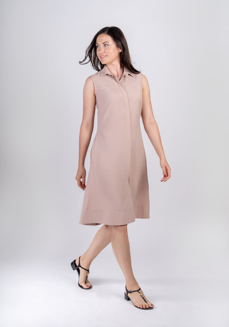 Woman walking and wearing Sonna dusty rose beige dress by AYANI and black sandals