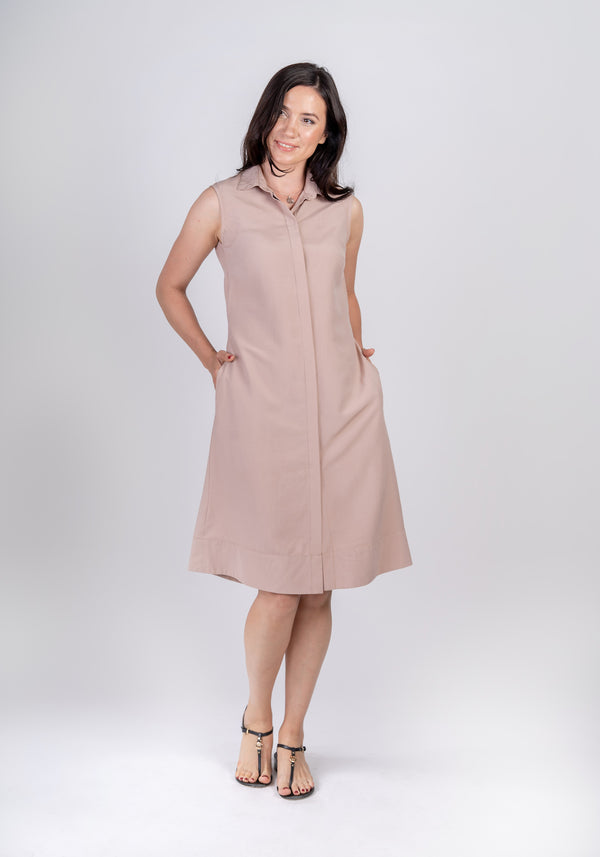 Woman wearing Sonna dusty rose beige dress by AYANI and black sandals