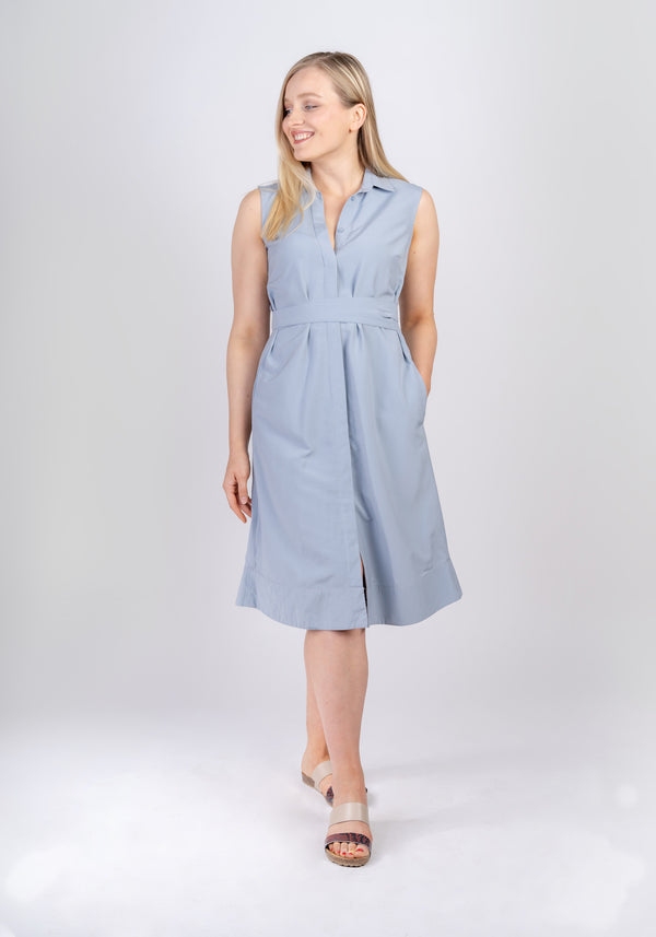 Woman wearing Sonna knee length belted powder light blue dress by AYANI and sandals