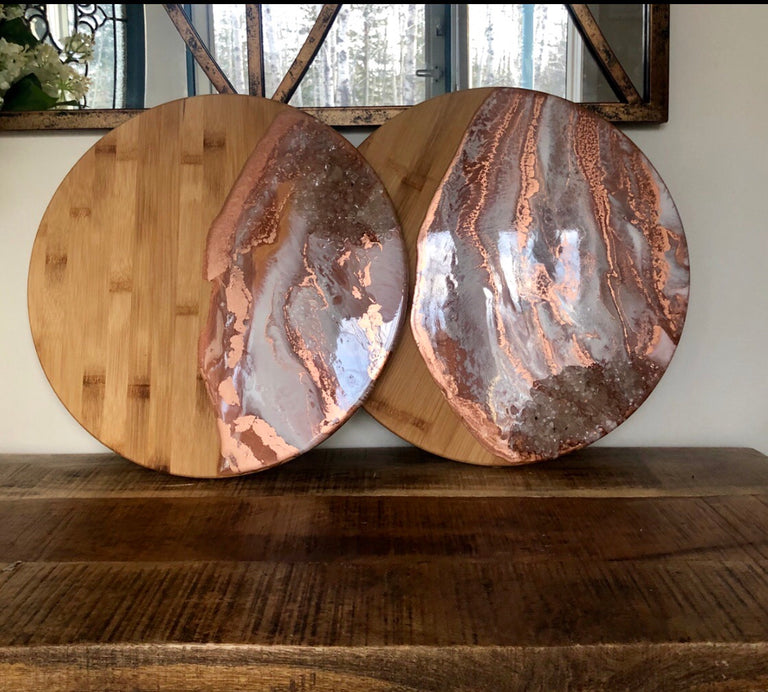 Round copper and white cheese boards with clear quartz