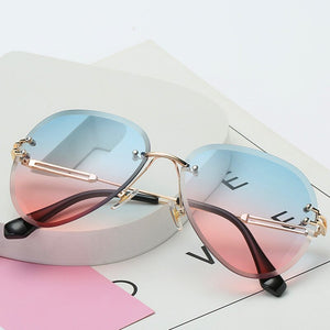 TOYEARN Gradient Shades Cutting Rimless Sunglasses Women High Quality Sexy Fashion Rimless Metal Sun Glasses UV400 Oculos De Sol