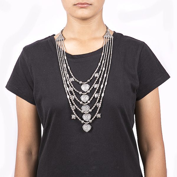 Antique multi layered handcrafted silver necklace with tribal art motifs and real pearls. Shriya Silver