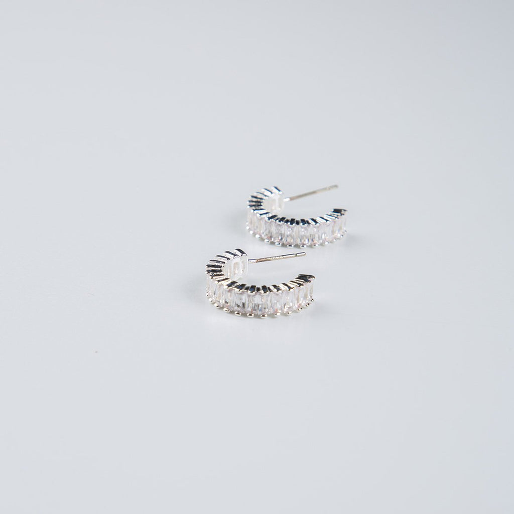 curAtiv proudly gives you Santiago Silver Plated and Crystal Cubic Zirconias Huggies Earrings.