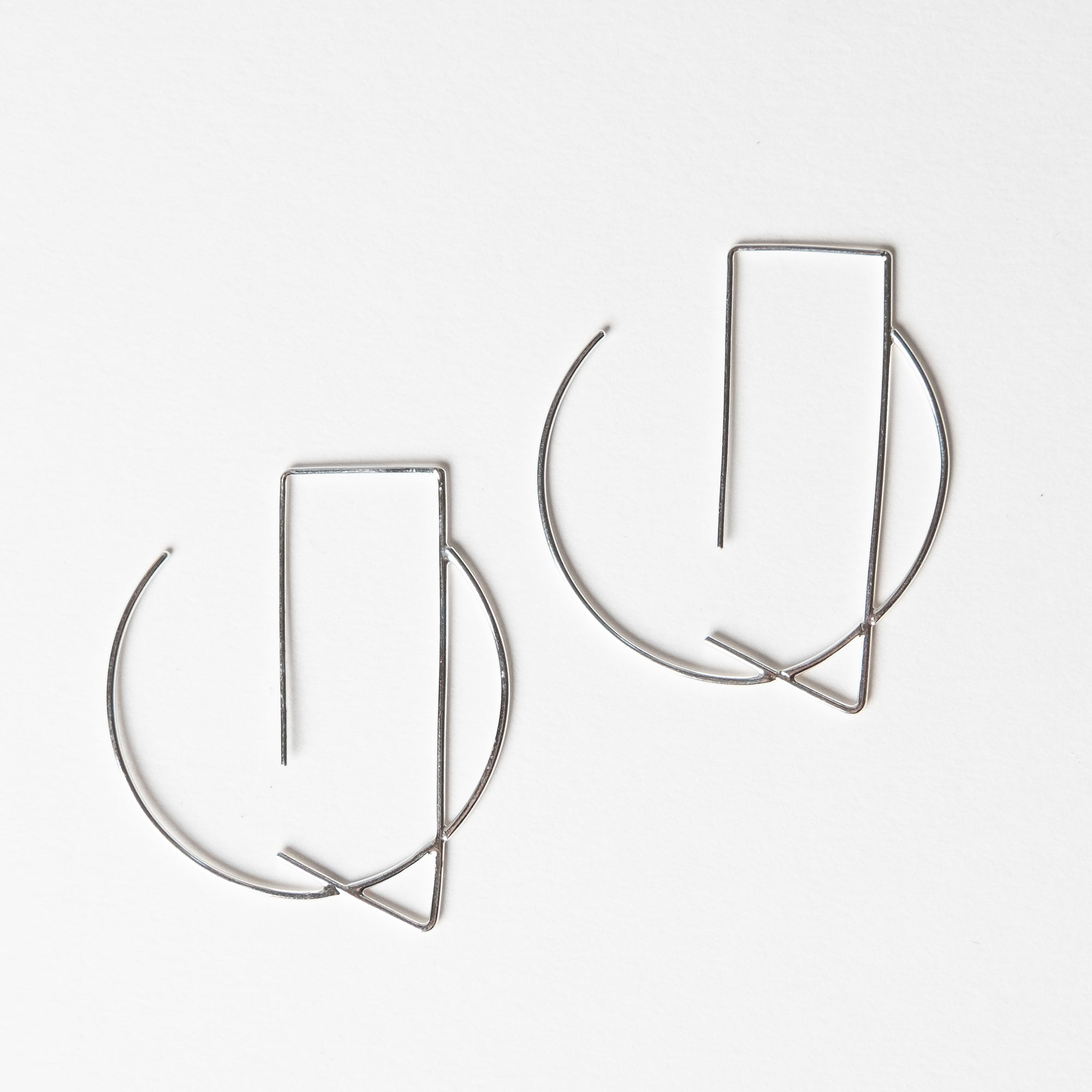 Delicate, silver hoop earrings with rectangular ear wire