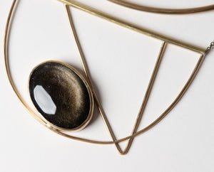 Large, brass, statement collar necklace with geometric design and golden obsidian