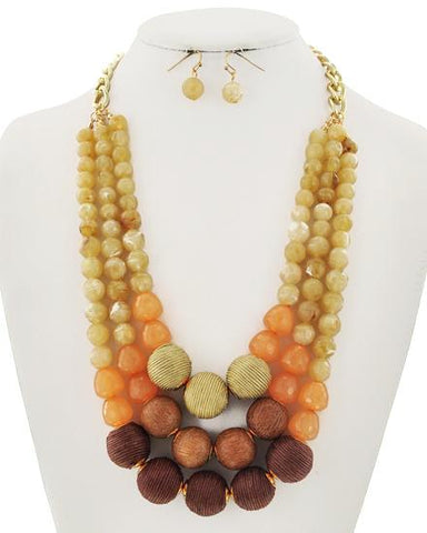 semi precious bauble set in yellow
