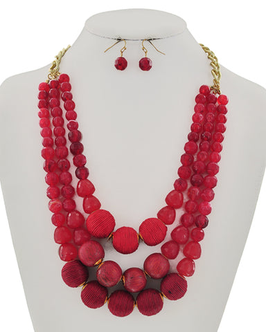 semi precious bauble set in red