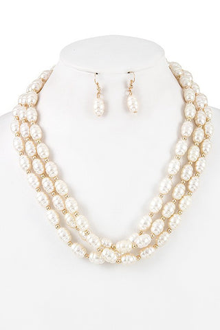 smooth pearl set with gold