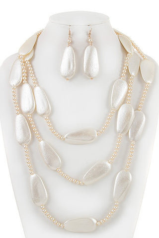 draped in creamy pearls set