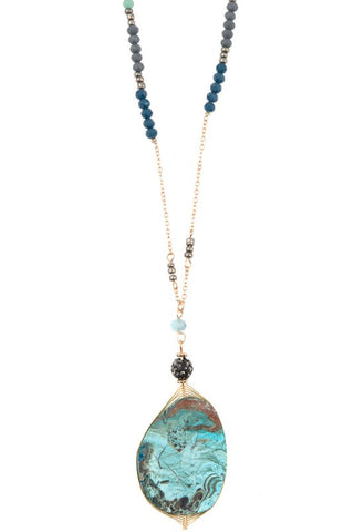 elongated stone pendant