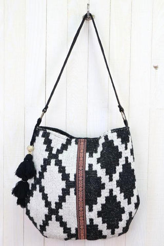 geo carpet bag with folklore trim