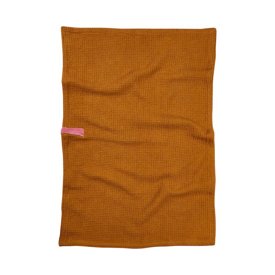 sage and clare - ananda tea towel in ochre