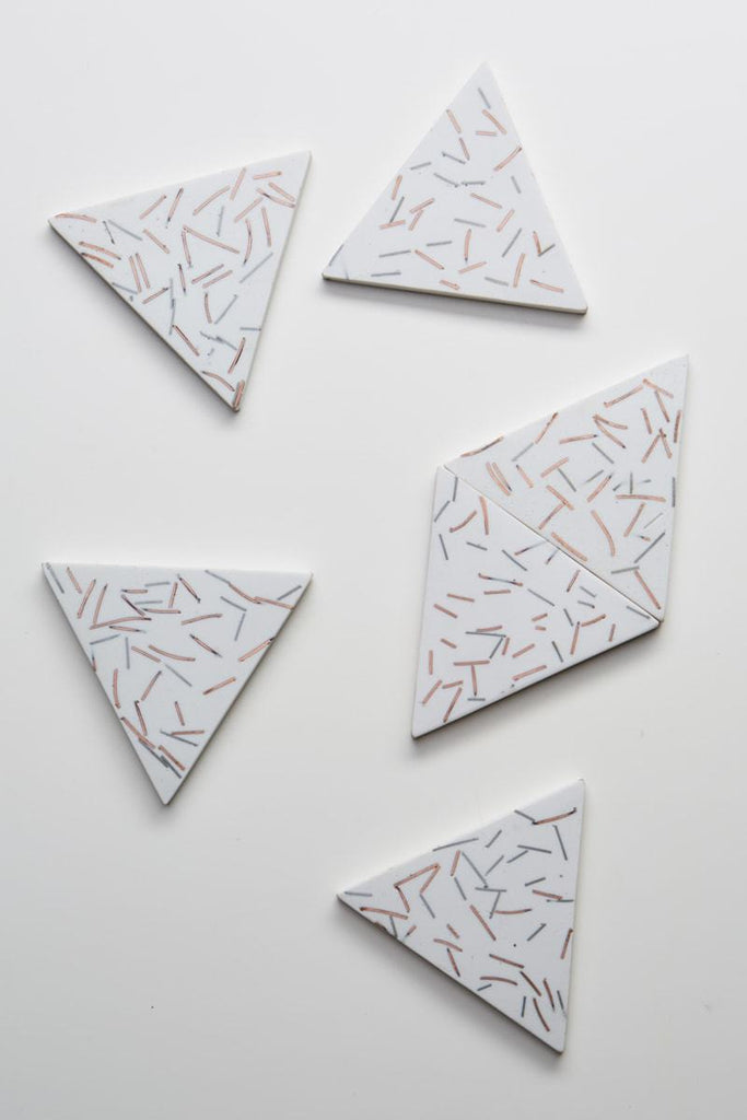 Capra Designs - match stick coasters in white match stick