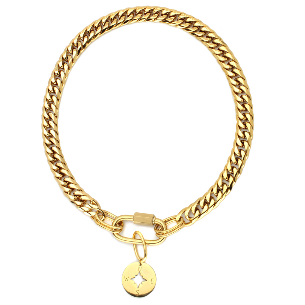 Elizabeth Necklace which is a gold chunky chain with oval lock and hanging compass pendant.