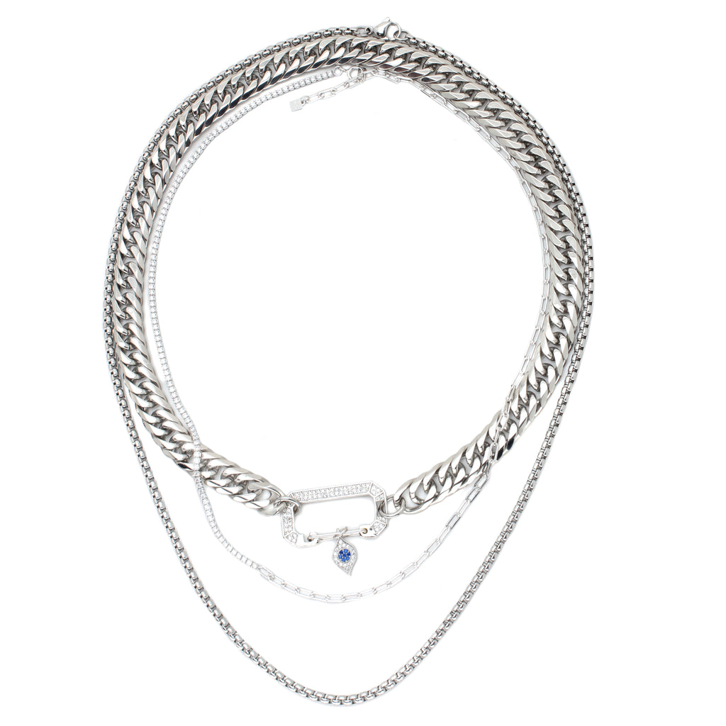 Indira chain which is a 3 layered chain, Sterling Silver chain and Zirconia carabiner and tiny charm with blue stones, half tennis necklace and half thin silver chain, the longest necklace is just a silver plain necklace.