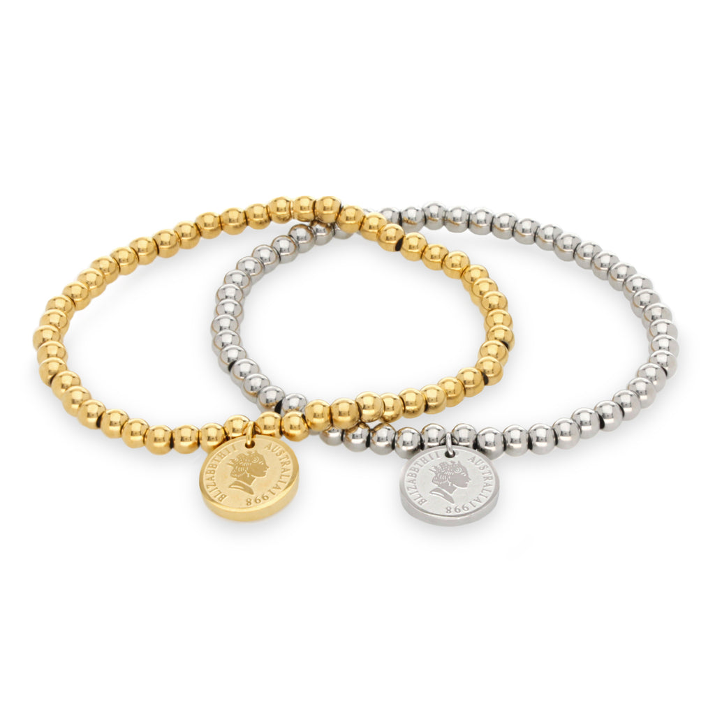 PUNTITOS COIN BRACELETS which are made of 18k gold plated and rhodium plated stainless steel beads and a coin charm.