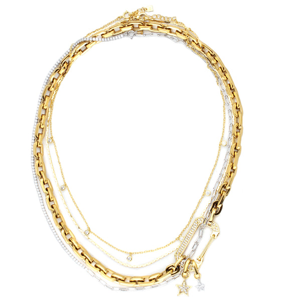 4 layered set Frida Necklaces comes with thin necklace with hanging stone crystals, thin plain necklace, gold chain with oval lock and two hanging star pendants. It also comes with a silver thin necklace which is half stones and half chain.