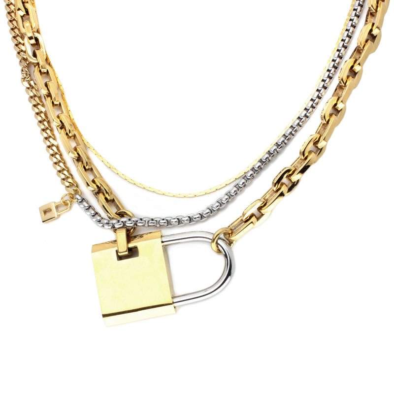 Margaret Necklace which is a 3  Layered Stainless steel chain set. It comes with a gold necklace with a lock pendant, thin gold necklace and another necklace that is half gold and silver with a tiny lock pendant.