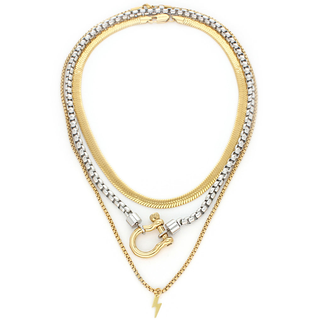 3 Chains Layered Set THE HERRADURA & THE SNAKE which comes with gold flat chain, Silver chain with gold herradura clasp and a gold plated long chain with a gold plated lightning bolt pendant.