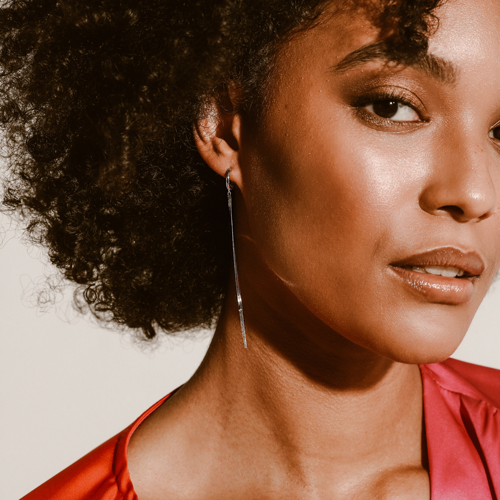 Spiga Huggies which is a 925 Sterling Silver earrings covered with Cubic Zirconia stones.