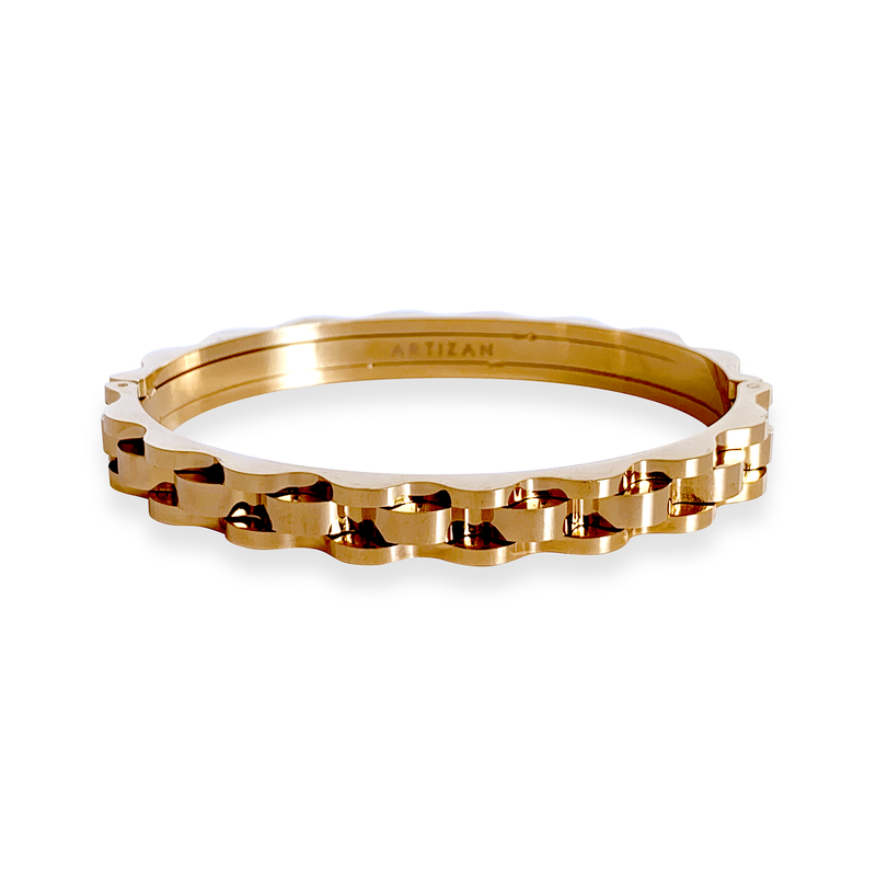 Bicycle chain bangle in shiny gold. Design is similar to a bicycle chain.