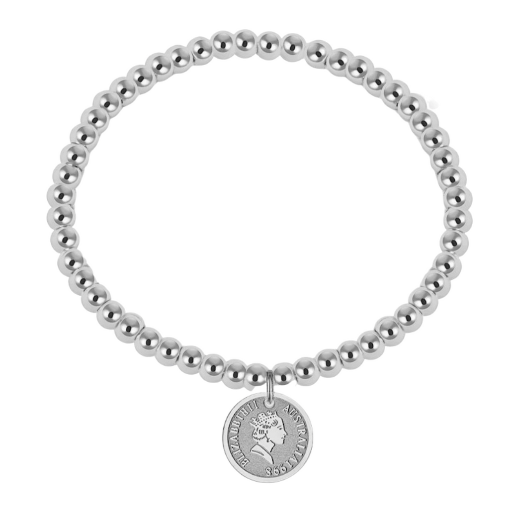 PUNTITOS COIN SILVER BRACELET which is made of rhodium plated stainless steel beads and a coin charm.