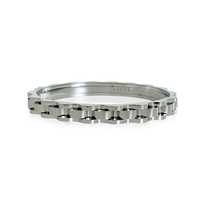 Bicycle chain bangle in silver. Design is similar to a bicycle chain.