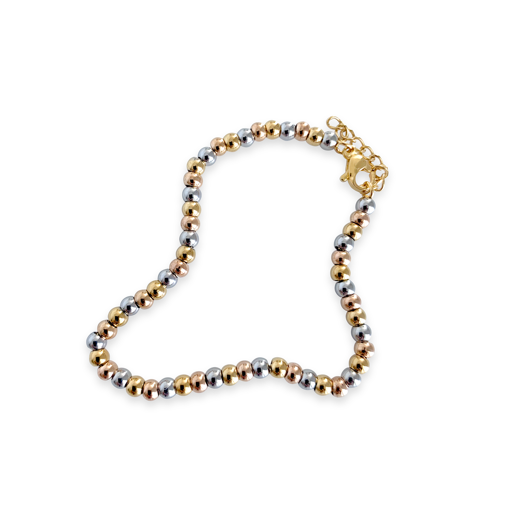 THE PUNTITOS Mix Small made of Stainless Steel Gold and Silver circle beads.