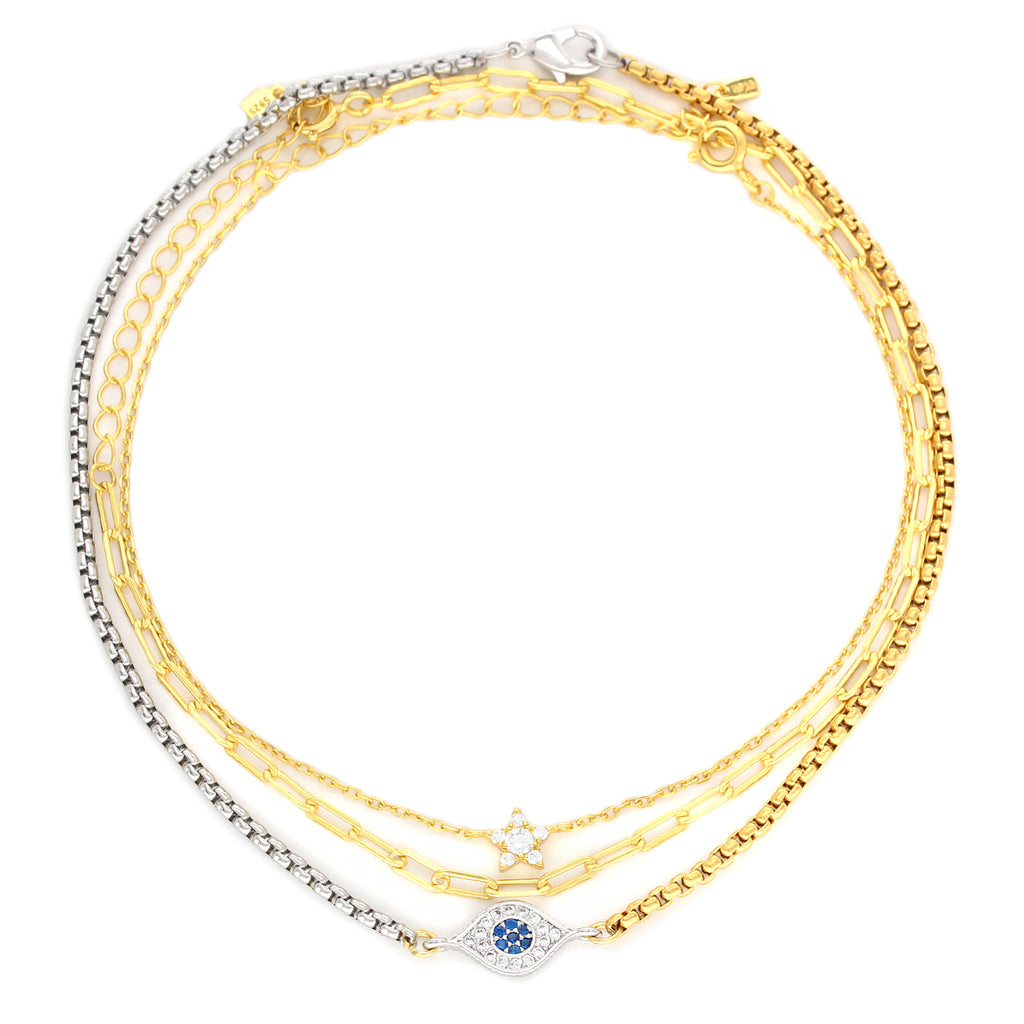 EVIL STAR ANKLET SET which comes with 3 anklets, thin gold anklet with diamond star charm, thin gold chain and a half gold and half silver chain with eye shaped charm in between and has blue stones and crystals.