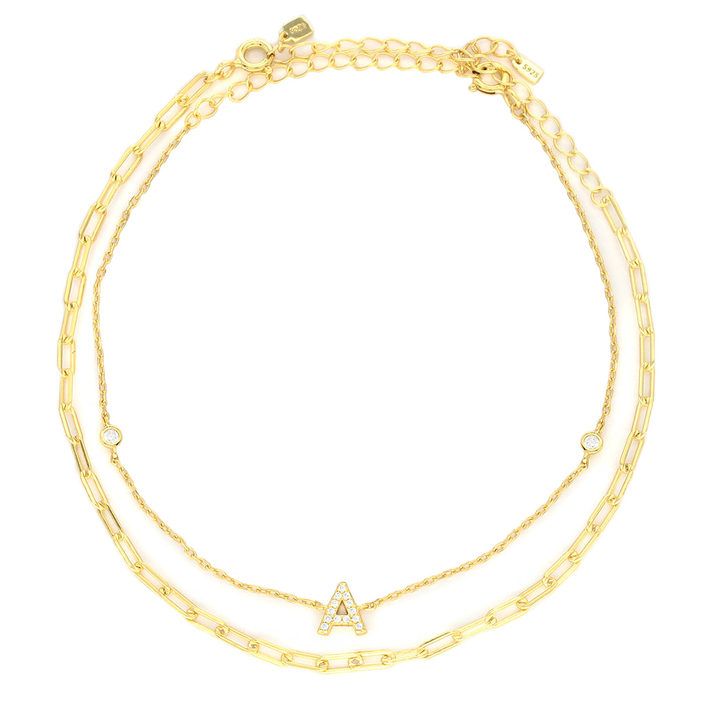 Letter ANKLET SET which comes with TWO 925 sterling silver, gold plated anklet. One with plain chain and the other comes with a  Zirconia letter charm and zirconia stones.