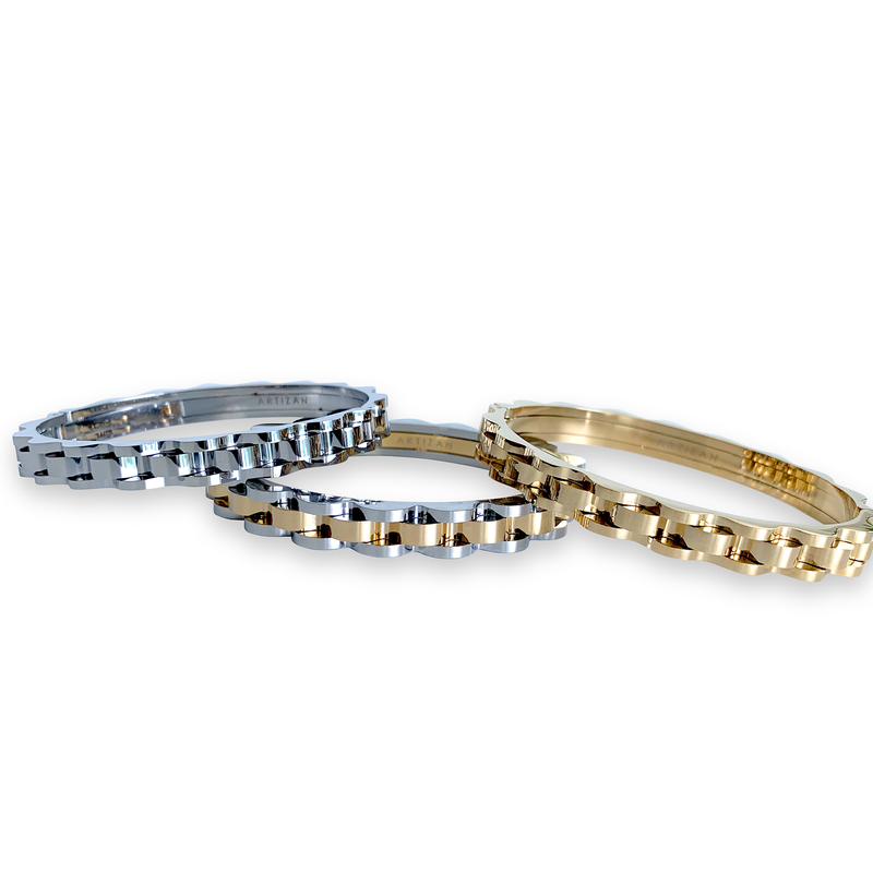 3 Bicycle chain bangles. One in the right is a silver bangle with bicycle chain design. In the middle is a mix of gold and silver bicycle chain designed bangle and on the left is the same design in gold tone.