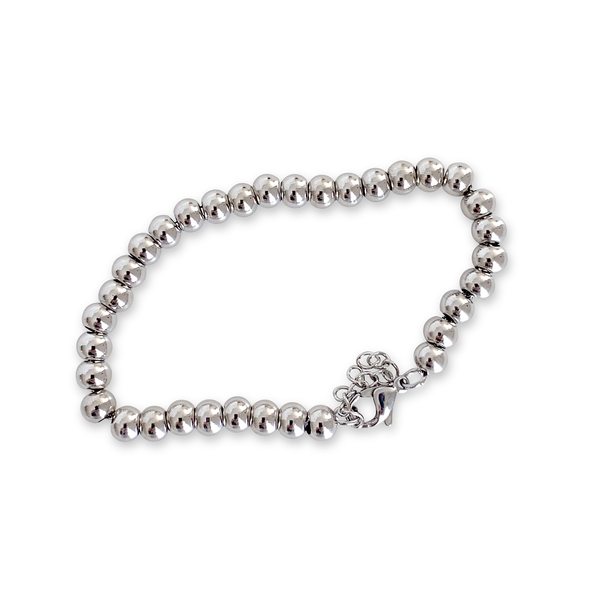 THE PUNTITOS Silver Medium which is made of Silver stainless steel circle beads.