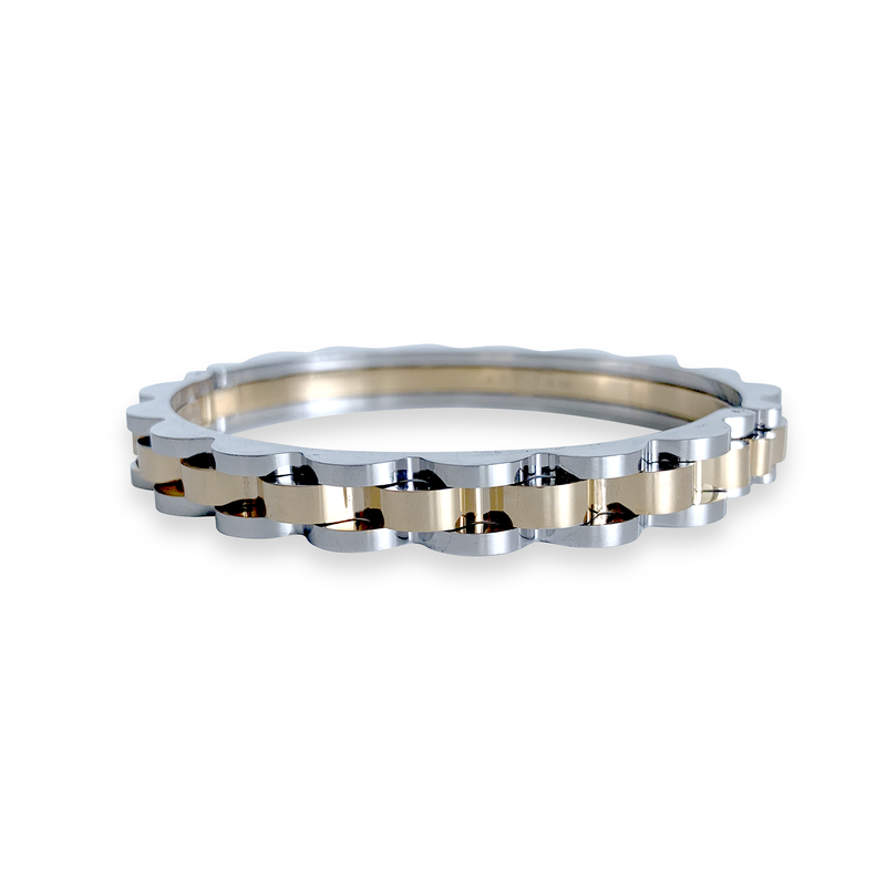 Bicycle chain bangle in mix gold and silver. Design is similar to a bicycle chain.