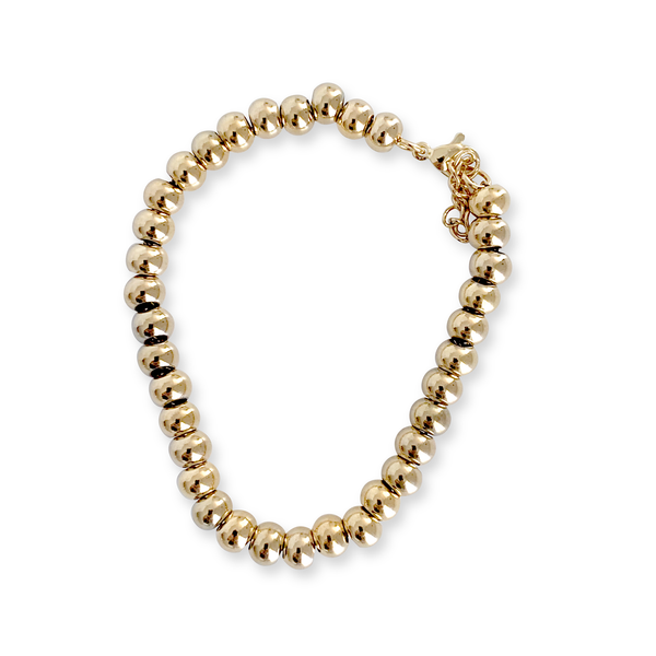 THE PUNTITOS Gold Medium BRACELET which is made of gold plated stainless steel circle beads.