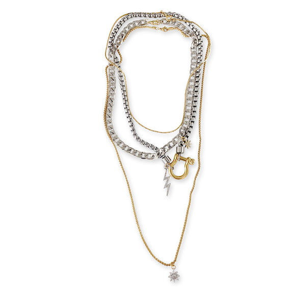 Herradura Chich Set which is a 4 Chains Layered Set. It comes with thin gold necklace, silver chain with gold herradura clasp and lightning bolt charm, flat silver chain and long thin chain with a Micro Pave sun pendant.