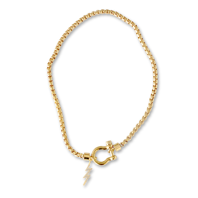 HERRADURA THUNDER SINGLE - GOLD which is a gold chain and gold Herradura clasp with lightning bolt pendant.
